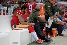 Kaepernick sits on bench during Anthem